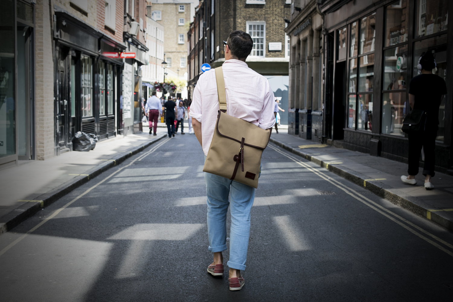 Jonny Trunk wearing the Original Peter Classic 12-inch LP Record Hunting Bag in Khaki while record hunting in Soho, London, England.